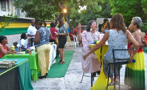 WMW Jamaica's mingle starts mingling on Saturday evening at the NGO's offices. (My photo)