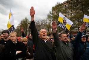 "Russian Neo-Nazis chant ""sieg heil"" in Moscow during a demonstration to celebrate Hitler's birthday. Russia is experiencing a surge of extremism, sometimes resulting in violent attacks on foreigners. Yes, CVM Television, nazism is alive and well. How insensitive and ignorant of you."