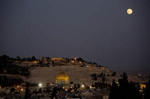 "Tonight's perigee moon (or ""super moon"") rises over Jerusalem's Old City and the Dome on the Rock. (Photo: Dusan Vranic/AP)"
