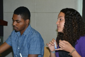 Public Affairs Intern Sybil Lewis, from the University of California at Berkeley shares tips with students while Rodje Malcolm (left),  Jamaican studying at Morehouse College, listens. (Photo: U.S. Embassy)
