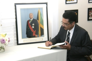 Jamaican Ambassador to the United States Stephen Vasciannie signs the condolence book for former Governor General Sir Howard Cooke in Washington, DC.