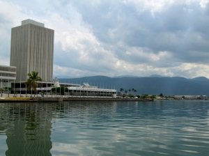 Approaching downtown Kingston's waterfront. From the boat, it seemed like a lonely, almost desolate place. There was almost no sign of life apart from some traffic. (My photo)