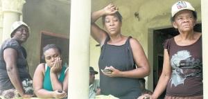 Relatives in shock after the murder of four residents in Middleton Meadows, Linstead. (Photo: Jamaica Observer)