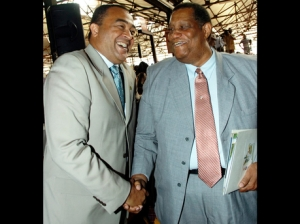 Chistopher Tufton (left), who was then the minister of agriculture, greets Roger Clarke, who was the opposition spokesman on agriculture at the time, during the launch of the Eat Jamaican campaign at the Coronation Market in Kingston on March 1, 2011. (Photo: Gleaner)