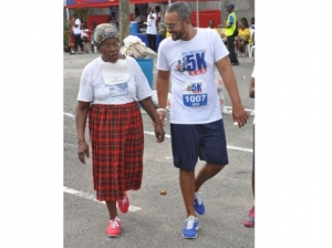 Managing Director of the Gleaner company Christopher Barnes has a few words of gratitude for 80-year-old Lillian Palmer who was a participant in the Gleaner 180 5K Run/Walk in Kingston. - (Photo: Jermaine Barnaby/Gleaner)