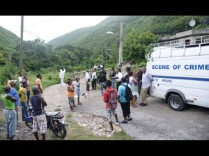 Curious onlookers at the cordoned-off area in August Town, where Constable James Grant was killed yesterday. (Photo: Gladstone Taylor/Gleaner)