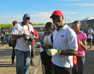 Oroyo Eubanks (in red cap) flashed me one of his trademark smiles, while his colleague O. Rodger Hutchinson (left) was thinking about it. They were there with colleagues from the Jamaica Information Service.