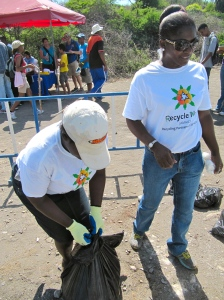 Truly hands on: Business Development Manager at Recycle Now/Recycling Partners Ann Marie Rodriques (right) with a colleague.