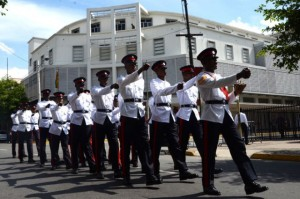 Members of the Jamaica Constabulary Force (JCF), who participated in Tuesday's (September 16) opening ceremony for the 2014 Michaelmas Term of the Home Circuit Court, march past the building housing three additional courtrooms in Justice Square, at the intersection of Kings and Barry Streets, downtown Kingston. (Photo: Jamaica Information Service)