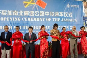 Prime Minister, the Most Hon. Portia Simpson Miller (fifth left), cuts the ribbon to officially open the Linstead to Moneague segment of the North/South Highway, today (August 5). Also participating are Opposition Spokesman on Infrastructure Development, Dr. Horace Chang (left); Regional Director for China Harbour Engineering Company (CHEC), Tang Zhongdong (third left), and Minister of Transport, Works and Housing, Dr. the Hon. Omar Davies (seventh left). (Photo: JIS)