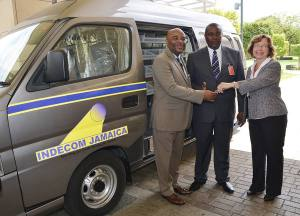 INDECOM Commissioner Terrence Williams (left) shakes hands with the U.S. Embassy's Charge d'Affaires