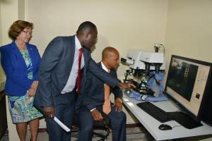 National Security Minister Peter Bunting (seated) looks at equipment donated by the U.S. and Canadian diplomatic missions to the National Forensic Science