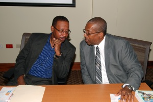 L-R: GKF Chairs Professors Ian Boxill (Carlton Alexander Chair in Management) and Dale Webber (James Moss-Solomon Snr Chair in Environmental Management) in deep discussion during the GKF/UWI Chair Press Conference on November 18, 2014 at the Council Room, UWI Regional Headquarters. (Photo: GraceKennedy Foundation)