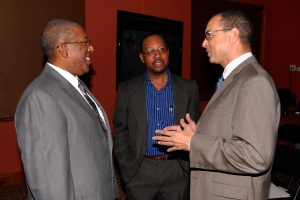 L-R GKF Chairs Professors Dale Webber (James Moss-Solomon Snr Chair in Environmental Management) and Ian Boxill (Carlton Alexander Chair in Management) being congratulated by GK Group CEO Don Wehby during the GKF/UWI Chair Press Conference on November 18, 2014 at the Council Room, UWI Regional Headquarters.