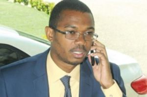 State Minister of Foreign Affairs and Foreign Trade Arnaldo Brown on the phone.