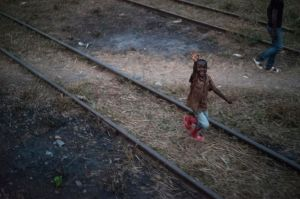 A Congolese boy waves to a train carrying hundreds of former refugees home to Angola. (Photo: UNICEF)