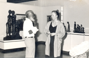 Veerle Poupeye speaks with artist Everald Brown (Brother Brown) at the National Gallery, circa 1987. Brother Brown passed away in 2003. You can read much more about this mystical, spiritual artist on the NGJ blog: https://nationalgalleryofjamaica.wordpress.com/2009/10/27/everald-brown-1917-2003/ (Photo supplied by Veerle Poupeye)