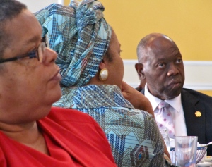(l-r) Permanent Secretary in the Ministry of National Security Carol Palmer, UNAIDS Representative and UN Resident Coordinator ad interim Kate Spring and Minister of Health Dr. Fenton Ferguson listen thoughtfully to the presentations at last week's breakfast.