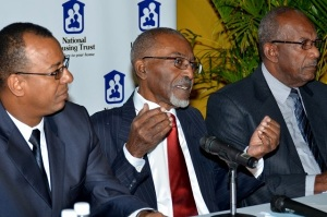 National Housing Trust (NHT) Chairman, Easton Douglas (centre) during a media briefing at the e on Monday. Flanking him are Board members, Norman Horne (left), and Percival LaTouche via the Jamaica Information Service.