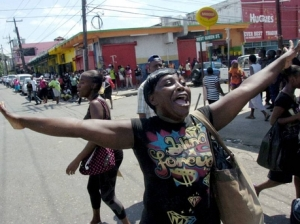 A vendor protests after her goods are confiscated by the police in downtown Kingston. (Photo: Gleaner)