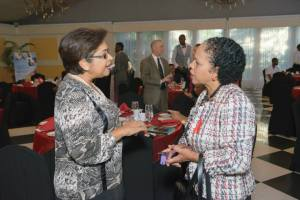 Chair of Digicel Foundation Jean Lowrie-Chin (left) in deep discussion with UNAIDS Country Director Kate Spring at the World AIDS Day Breakfast Forum. (Photo: J-FLAG)