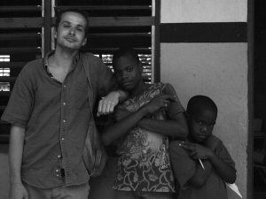 Luke Somers posing with boys in Trench Town, 2010. (Photos are all from the Friends of the Trench Town Reading Centre Facebook page).