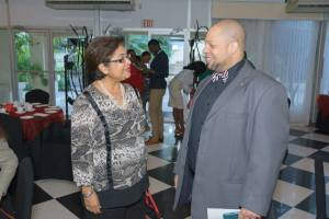 Chair of the Digicel Foundation and founder of the Caribbean Community of Retired Persons Jean Lowrie-Chin talks to Executive Director of J-FLAG Dane Christian at the breakfast. (Photo: J-FLAG)