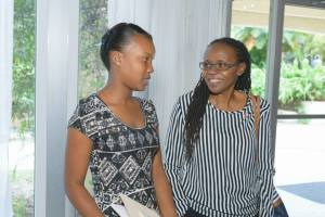 Rushell Gray (left) talks with her mentor Marjorie of Eve for Life at the World AIDS Day Breakfast. (Photo: J-FLAG)