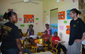 Luke with the children and Sweets at the Trench Town Reading Centre.