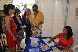(l-r) Elizabeth Lee Martinez, Charge d'Affaires at the U.S. Embassy, Dr. Denise Chevannes and Chair  Dr. Sandra Knight at the Ministry of Health's national HIV testing expo in Mandela Park on World AIDS Day. (Photo: U.S. Embassy)