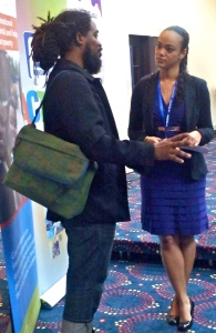 """Two speakers at the National Volunteer Symposium, Miguel """"Steppa"""" Williams and Kimberley Issa Sherlock chat at the JN Foundation's National Volunteer Symposium on December 5. (My photo)"""