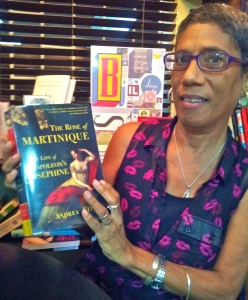 """Margaret with her recommended book, """"The Rose of Martinique."""""""