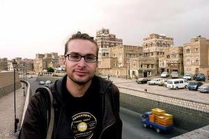 Luke Somers in Sana'a, Yemen, wearing a Trench Town Reading Centre T shirt.
