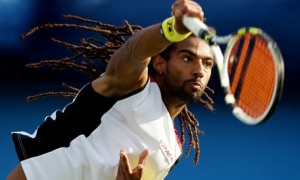 Born in Germany to a German mother and Jamaican father, Dustin Brown went to school in Jamaica and has great loyalty to his roots, but received no funding support and now plays for Germany. He beat world #1 Rafael Nadal in Germany in June of this year. (Photo: Guardian UK)