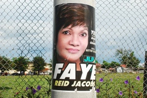 On December 1, the JLP's Faye Reid Jacobs lost to the PNP's Dwayne Vaz with 6,228 votes to Vaz' 8,720 votes. (Photo: Loop Jamaica)