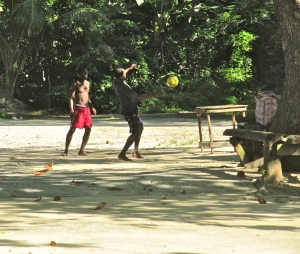 An idle game of football at Winifred's Beach. (My photo)