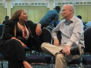 The tremendously supportive Dr. Denise Chevannes of the National Family Planning Board of Jamaica chats with U.S. Peace Corps' Anthony Hron before J-FLAG's 16th Anniversary celebrations. (My photo)