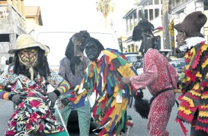 Jonkanoo in Annotto Bay. Pity about the Hallowe'en masks… (Photo: Everard Owen/Jamaica Observer)
