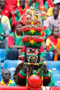 A stunningly elaborate headdress on a football fan from Burkina Faso.