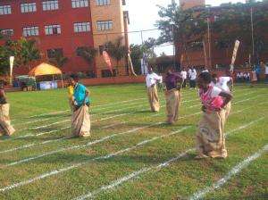 Parents compete in a sack face at the Kampala Parents Reunion in Uganda. (Photo: New Vision Uganda/Twitter)