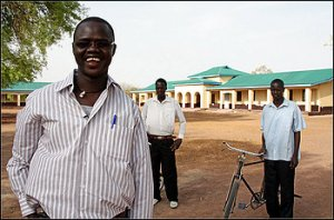 """Former """"lost boy"""" Valentino Achak Deng outside the school he has built in his former village of Marial Bai, South Sudan through the Valentino Achak Deng Foundation. (If you have not read his amazing biography """"What Is the What"""" - you really should!)"""