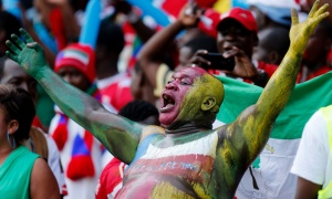An Equatorial Guinea fan cheers his team on at the African Cup of Nations. (Photo: Mike Hutchings/Reuters)