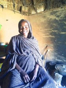 27-year-old Darfuri refugee Hosna lives in a camp in Touloum, Chad. It is now a strong village for 30,000 built with adobe mud walls by the refugees themselves, replacing tattered tents. (Photo: iactivism.org)