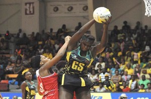 The Jamaicans and English battling it out at the National Indoor Centre today. (Photo: Garfield Robinson/Jamaica Observer)