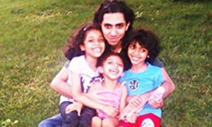 Raif Badawi with his children. His wife says they are traumatized by his flogging.