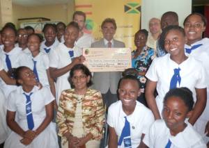 Students of Mt. Alvernia High School receive a large cheque from the Spanish-Jamaican Foundation for Spanish exam fees. (Photo: Spanish-Jamaican Foundation/Facebook)