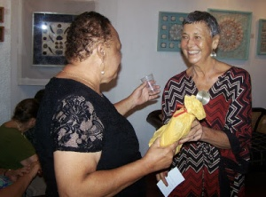 Annabella Proudlock (right) chats with broadcaster Barbara Gloudon at the opening of her own art exhibition in October, 2013.  Her own art work includes delicate collages of shells and found objects, revealing her love of nature. (Photo: Tallawah Magazine)