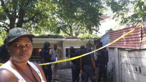 A murder scene in August Town. Please can we see less yellow tape? (Photo: Loop Jamaica)