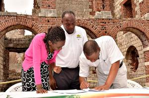 Colin McDonald, CEO of Our Story Tours Limited (right) signs the lease agreement with Chair of the Old Harbour Development Area Committee Randy Finikin and Kadene Campbell, the Jamaica National Heritage Trust's legal officer, at Colbeck Castle. (Photo: Old Harbour News)