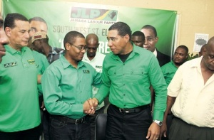 Floyd Green (left) shakes hands with JLP leader Andrew Holness at G2K's youth conference yesterday. (Photo: Richard Hamilton/Jamaica Observer)